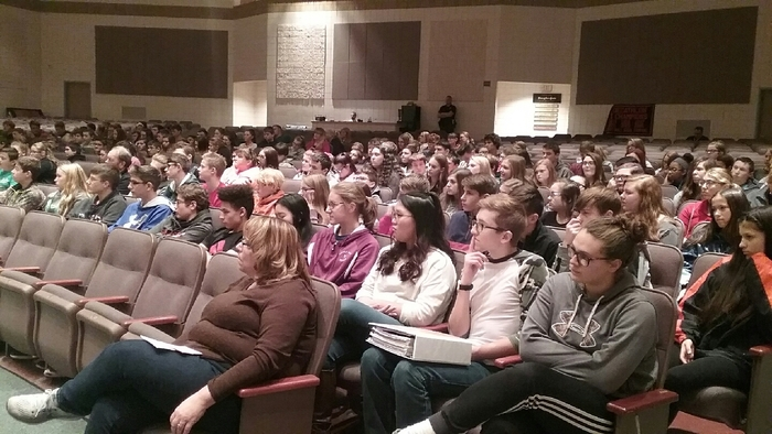 students listening attentively to veterans